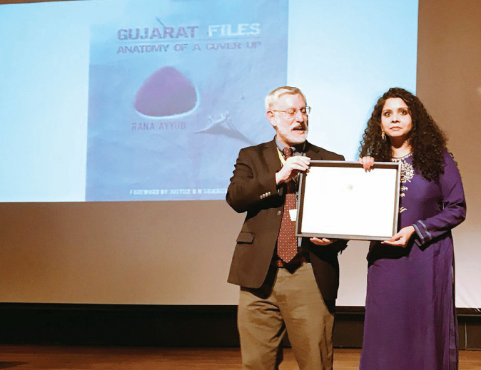 Rana Ayyub received Citation of Excellence in Global Shining Light Award for 'Gujarat Files: Anatomy of a Coverup'