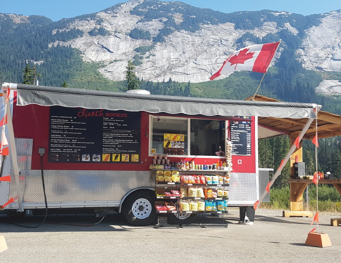 Trucker travel enhanced with food trucks at key locations